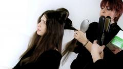 Fashion top model getting hair done by hairdresser 2 Stock Footage