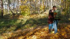 Autumn  Romance - Romantic couple walking in autumn forest. Slow motion Stock Footage