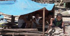 4K / HD Children In Slum Shelter From Sun Philippines Stock Footage