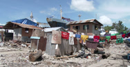 Stock Video Footage of 4K / HD Bright Laundry In Shanty Slum Housing Philippines