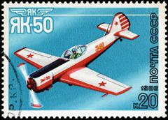 """Stock Photo of ussr - circa 1986: a stamp printed in ussr shows the aviation emblem """"yak"""" an"""