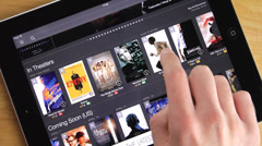 Browsing Movies Videos On iPad Tablet - stock footage