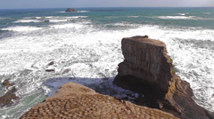 Two high rock ocean rock formatations home to the gannet bird colonies angle 3 - stock footage