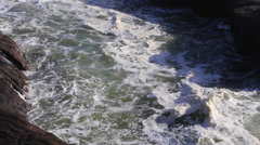 Shot of the rock formations at the Murawai ocean shore Stock Footage