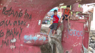 Stock Video Footage of HD Children Sit On Ship Propeller In Philippines Slum