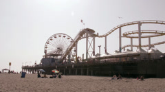 Wide shot of Santa Monica Pier with roller coaster Stock Footage