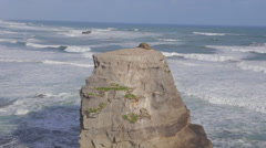 Close shot of ocean rock cliff zoomed to wider shot Stock Footage