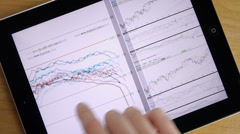 Business Graphics Sheets On iPad Tablet - stock footage