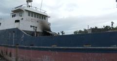 4K / HD Typhoon Haiyan Huge Ships Washed Ashore By Storm Surge Stock Footage