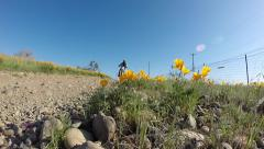 MOTOCROSS MOTORCYCLE RIDING FAST THOUGH FLOWER FIELD EXTREME HD VIDEO Stock Footage