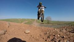 MOTOCROSS JUMP AIR OVER CAMERA REALTIME TO EXTREME SLOW MOTION DIRT BIKE HD Stock Footage
