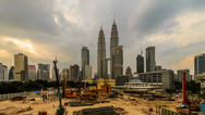 Stock Video Footage of Sunset At KLCC Construction Site Zoom In