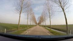 NETHERLANDS vehicle shot straight road in Beemster polder, village at horizon Stock Footage