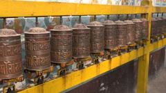 Spinning Tibetan Buddhist prayer wheels at Boudhanath stupa in Kathmandu, Nepal Stock Footage