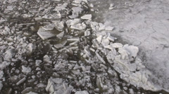 beginning of  ice drift on spring time  river - stock footage