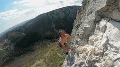 Rock climber high up on limestone cliff HD Stock Footage