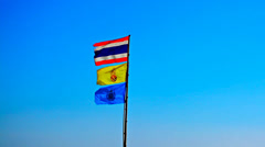Thailand flags on blue sky background Stock Footage