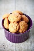 meringue almond cookies in bowl - stock photo