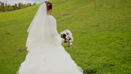 Stock Video Footage of bride walks around the hill