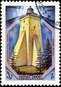 ussr - circa 1983: a stamp from the ussr shows image of a baltic sea lighthou - stock photo