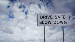 Sign Drive Safe Slow Down Clouds Timelapse Stock Footage