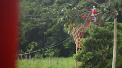 Ziplines through a tropical jungle rainforest Stock Footage