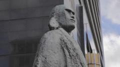 High to tilt of an interesting Maori warrior statue downtown Auckland Stock Footage