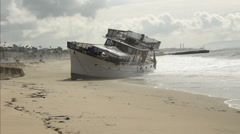 Boat Aground on Beach Stock Footage