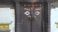 Ornamental ancient door with Buddha eyes in Katmandu, Nepal Stock Footage