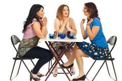 Two women congratulate their friend Stock Photos