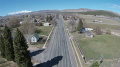 Aerial main street small rural village mountains HD 042 Stock Footage