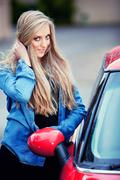 young girl and her car - stock photo