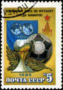 ussr - circa 1985: a stamp printed by ussr shows football players. junior wor - stock photo