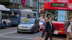 Commuters cross george street to walk to work, sydney, australia Stock Footage
