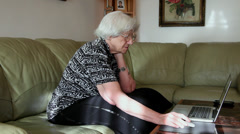 Elderly woman working with computer, modern techology, using laptop Stock Footage