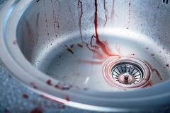 close-up shot of bloody kitchen sink - stock photo