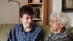 Grandmother and grandson chatting, gossiping, generations Stock Footage