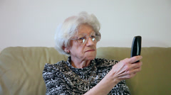 80 years old woman dialing a phone number,gossiping, talking too much, time laps Stock Footage
