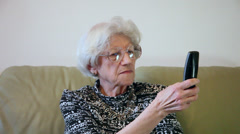 80 years old woman dialing a phone number, grandma, conversation Stock Footage