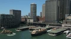 Sydney ferries leave circular quay, australia Stock Footage