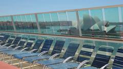 Cruise ship deck and loungers pan to sydney opera house, australia Stock Footage