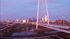 Dallas Skyline aerial at Dusk w/ margaret hunt hill bridge Stock Footage