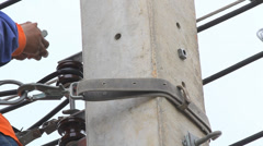 making repairs at a power pole. - stock footage