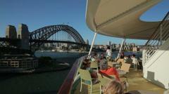 cruise ship passengers enjoy view of sydney harbour bridge, australia - stock footage