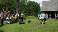 Country musicians play folklore music sing and pair dance Stock Footage