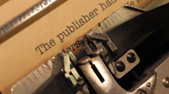 The typewriter with an publishing contract text Stock Footage