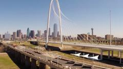 Dallas Skyline by helicopter thru Margaret Hunt HIll Bridge Stock Footage