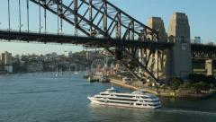 Captain cook cruise boat passes under sydney harbour bridge, australia Stock Footage