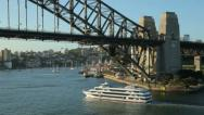 Stock Video Footage of captain cook cruise boat passes under sydney harbour bridge, australia