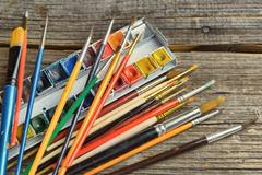 Artist brushes and paints Stock Photos